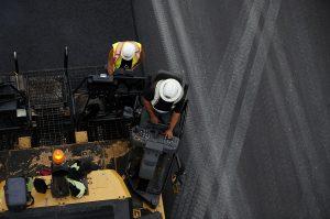 overhead view of asphalt paving process