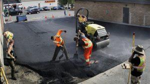 Asphalt paving a commercial parking lot