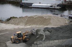 Front end loader pushing aggregate