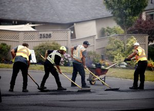 crew of workers paving residential street