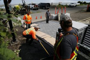 paving a residential footpath with asphalt